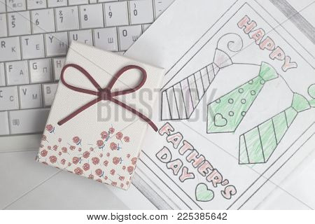 Greeting Card For Father With A Giftbox On Notebook. Fathers Day Concept.