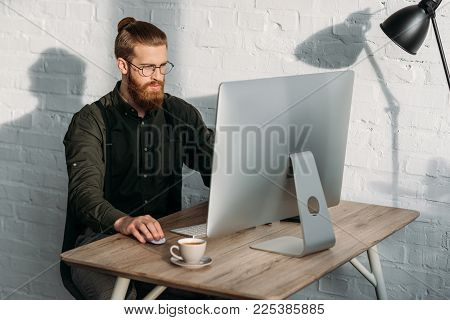 handsome businessman working with computer in office poster