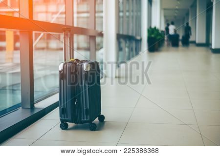 Suitcases or Baggage in airport departure lounge, summer vacation concept, traveler suitcases in airport terminal waiting area.