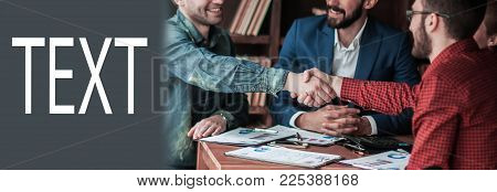 reliable business partners shake hands after discussing the contract for the work space in the office.