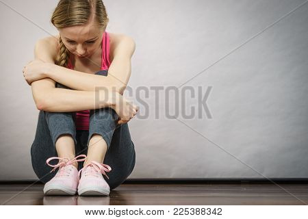 Sad Depressed Young Teenage Girl Sitting By Wall Hiding Face. School, Adolescence, Home Violence, Un