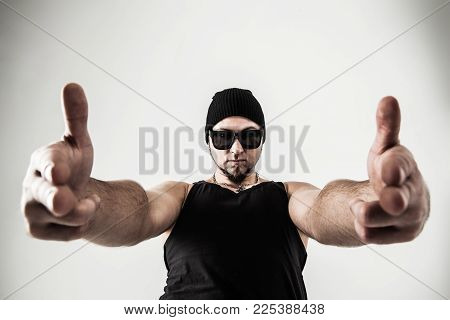 closeup of a DJ - rapper headphones hands shows gesture thumbs up.the photo has a empty space for your text