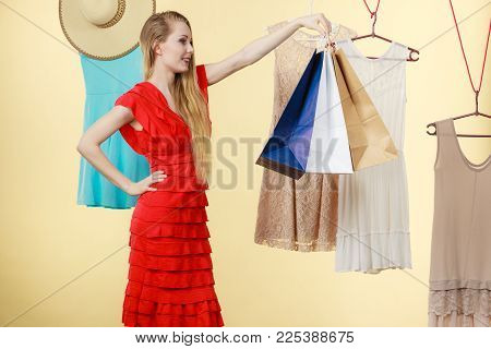 Woman In Shop Picking Summer Clothes, Making Perfect Outfit, Choosing Clothing From New Collection,
