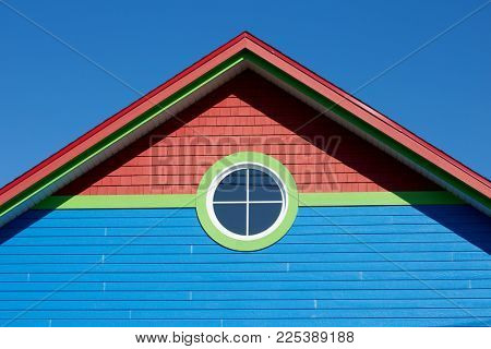 Blue rooftop with round window in Iles de la Madeleine in Canada