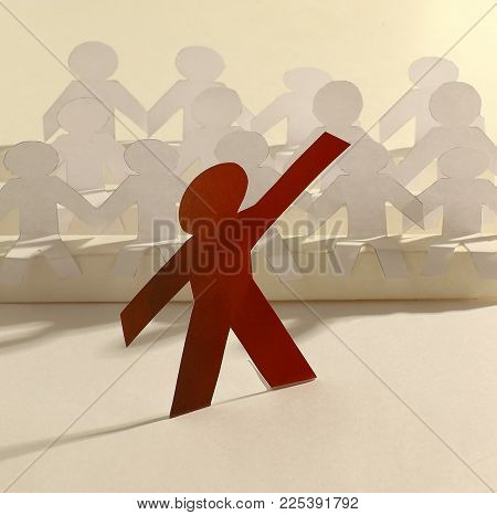 leader standing in front of a group of paper doll. photo with copy space