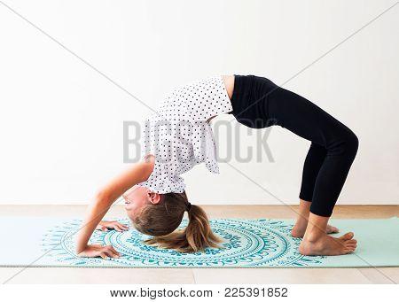 Little Girl Doing Yoga Exercise