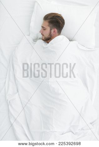 view from the top.smiling man lying on a comfortable mattress