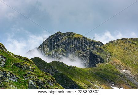 Mountain Peak Over The Cliff And Clouds. Beautiful Summer Scenery Of Fagaras Mountains