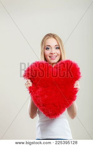 Valentines Day Love And Relationships Concept. Blonde Long Hair Young Woman Holding Heart Shaped Pil