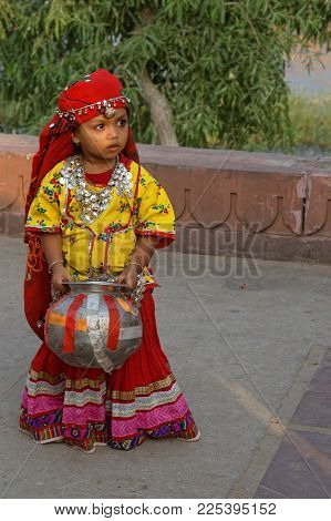 JAIPUR, INDIA, October 26, 2017 : Indian people like to have photographs in traditional dress, even children. Jaipur is a popular tourist destination in India. and serves as a gateway to other tourist destinations in Rajasthan