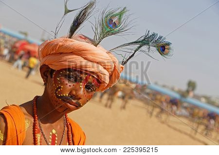 PUSHKAR, INDIA, October 28, 2017 : Portrait of a boy during the festival. Pushkar Camel fair is one of the largest cattle fairs in the country with thousands of animals.