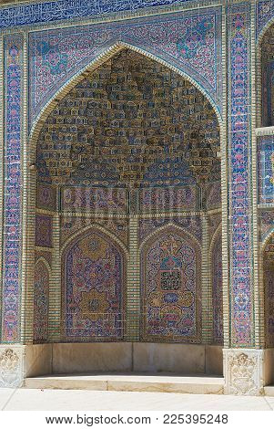 SHIRAZ, IRAN - JUNE 20, 2007: Exterior wall decoration of the Nasir al-Mulk mosque in Shiraz, Iran.