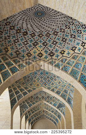 SHIRAZ, IRAN - JUNE 20, 2007: Ceiling decoration of the Nasir al-Mulk mosque in Shiraz, Iran.