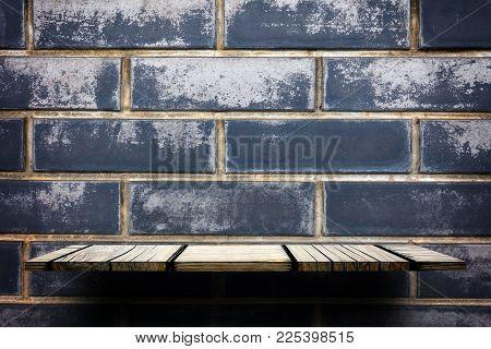 Empty Blank Wooden Display Shelf On Gray Brick Wall