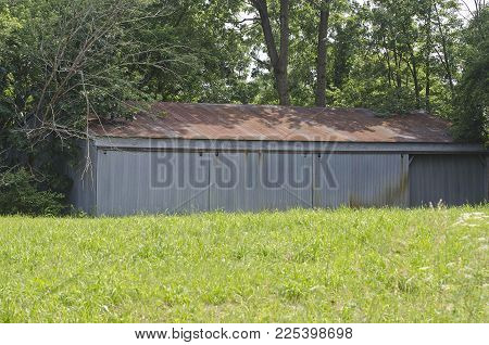 This shed could have of variety of interesting things behind each of the doors. It's just a matter of picking the correct one.