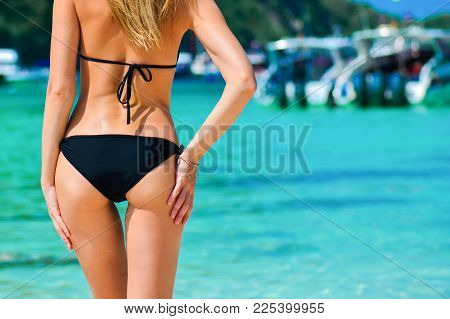 Sexy Woman Buttocks On Tropical Beach Background Near Ocean. Close Up Outdoor Shot Of Young Woman In