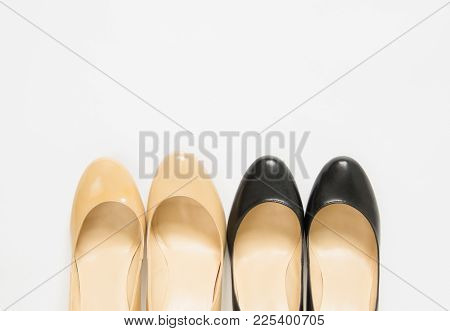Black And Cream Heeled Women's Shoes On White Background.