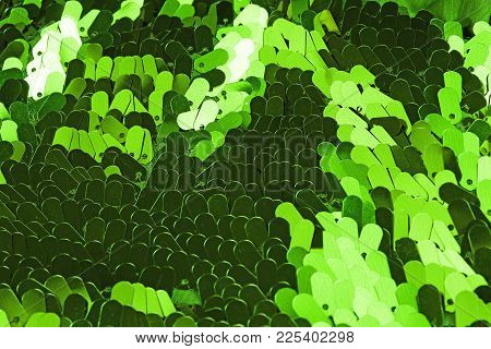 Fashion Sequin Design Designer Dress Fabric Cloth Material. Sequins As Background. Green.