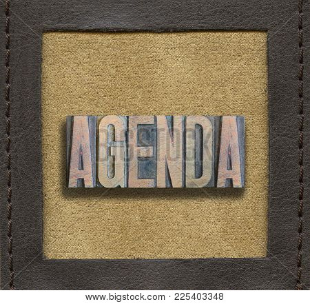 Agenda Word Assembled From Vintage Wooden Letterpress Inside Stitched Leather Frame