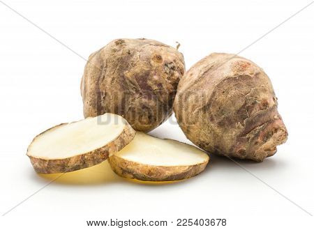 Two Jerusalem Artichoke Tubers With Two Round Slices Isolated On White Background Sweet Crisp Topina