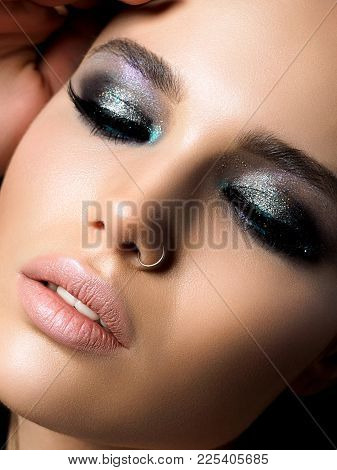Close Up View Of Young Beautiful Woman. Perfect Skin And Evening Makeup. Silver Smokey Eyes. Macro S