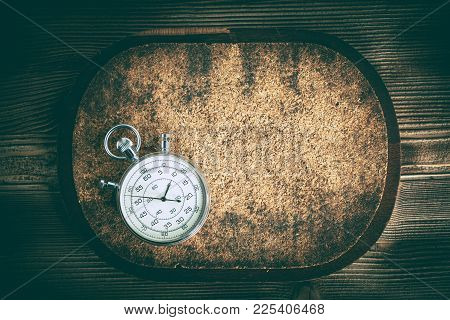 An Old Stopwatch On A Cork Background. Vintage Style.