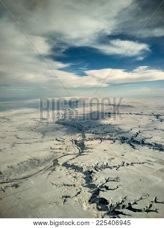 Aerial View Of Canadian Flat Winter Landscape In Winter From An Airplane