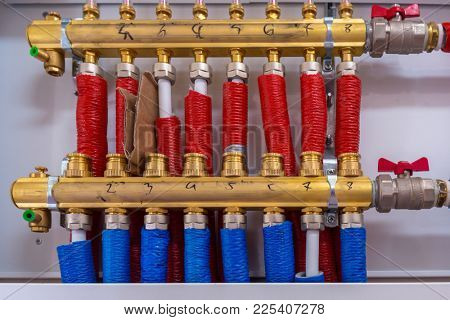 Water pipes of central heating system in boiler room