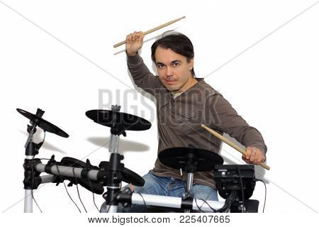 Middle Aged Drummer With Drumsticks In His Hands Playing Electronic Drum Kit. Isolated On A White Ba