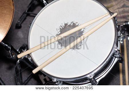 Closeup Image Of A Drum With Drum Sticks