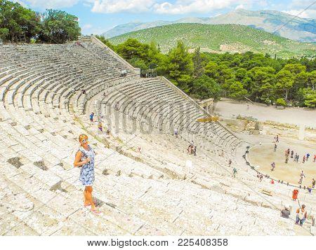 Epidaurus, Greece - July 18, 2017: Ancient Greek Amphitheater Epidaurus, Island Of Peloponnese, Gree