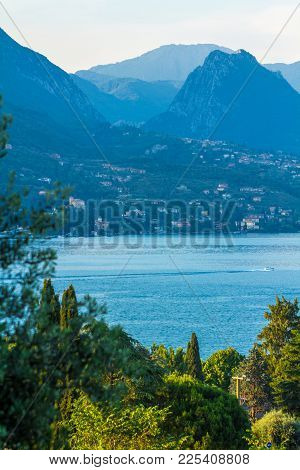 Lake Garda, Italy. Peaceful Sunset Looking Out Over The Lake From Maraschina Toward The Mountains