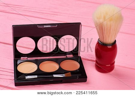 Eyeshadows Palette And Shaving Brush. Set Of Brown Color Eyeshadows. Female Hygiene And Beauty Conce