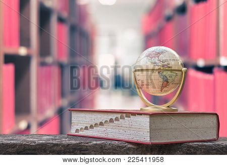 February 13, 2018 - Bangkok, Thailand: Globe Model On Textbook, Or Dictionary On  Table In School Or
