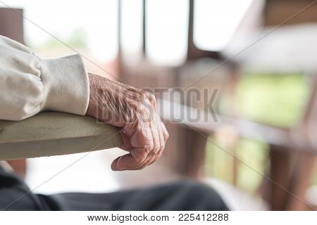 Parkinson Disease Patient, Or Alzheimer Elderly Senior Person In Support Of Nursing Family Caregiver