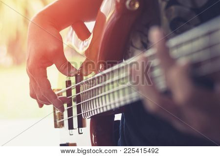 Bass Guitar Player Playing Music Instrument (focus On Hand)