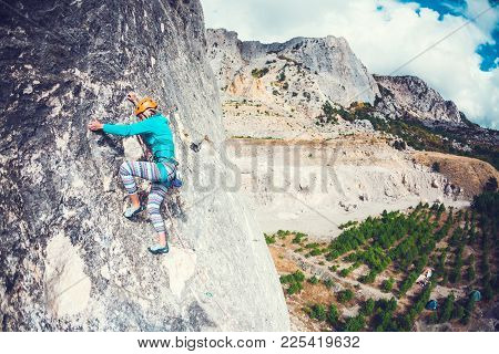 Girl Climbs The Rock.