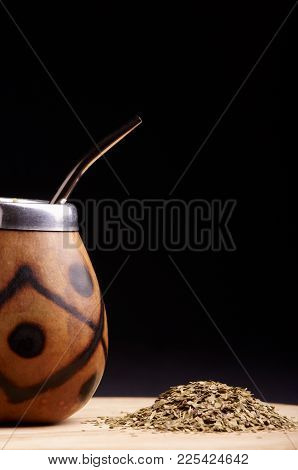 Traditional South American Yerba Mate Tea In The Calabash Circle And Bombilla. Black Background. Clo