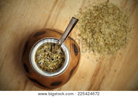 Traditional South American Yerba Mate Tea In The Calabash Circle And Bombilla. Wooden Background. To