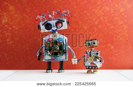 Family Robots. Big Robot Mom Holds The Hand Of A Small Child Robot. Creative Design Futuristic Cybor