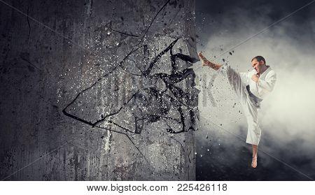 Man in kimono break wall. Mixed media
