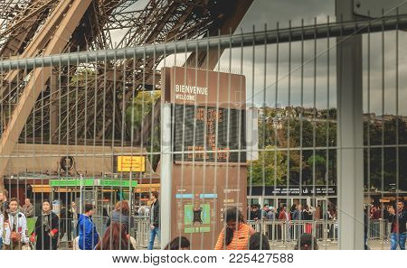 Behind Barriers Of Intrusion Protection Panel Welcomes Visitors To The Eiffel Tower