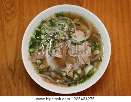 Vietnamese rice noodle soup with sliced rare beef.