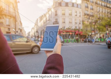 Woman Using Cellphone And Crossing The Street.