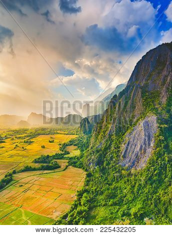 Aerial view of the fields and mountain. Beautiful landscape. Vang Vieng. Laos.