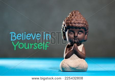 Believe In Yourself Confident Encourage Motivation Concept With Meditating Or Praying Baby Buddha.