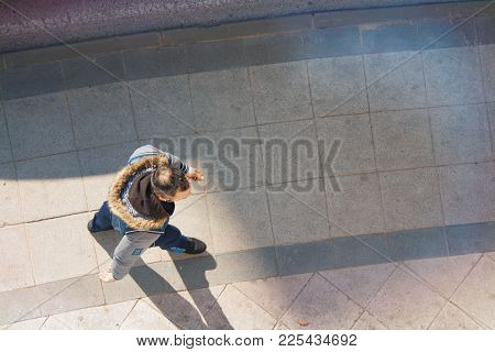 Passers-by Are On The Sidewalk Path, Top View