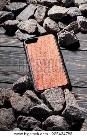 Exclusive Brown Wooden Case For Smartphone.luxury Case. On Stone Background