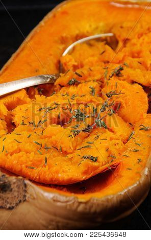 Baked Pumpkin With A Tender, Juicy Pulp Flavored With Thyme. Close-up.