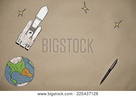 Drawing The Launch Of A Rocket Falcon Into Space On The Background Of The Earth Made On Craft Paper,